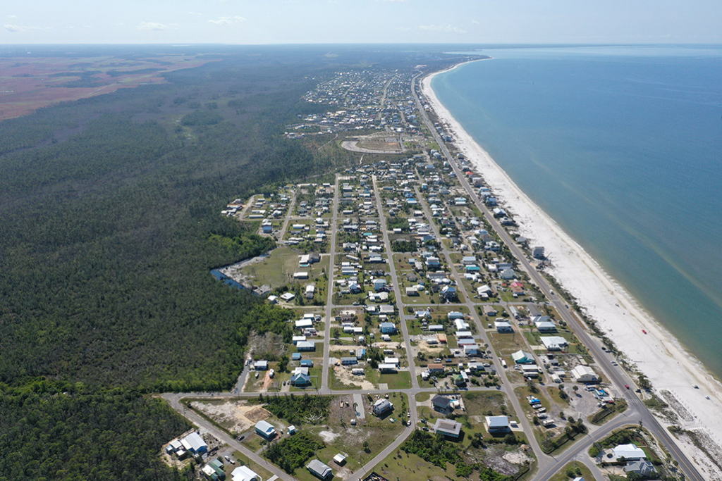 Moving along the coast over Mexico Beach from the air.